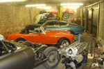 General workshop showing E Type, MG Midget, Vignale, Porsche 911 above a Morris 10
